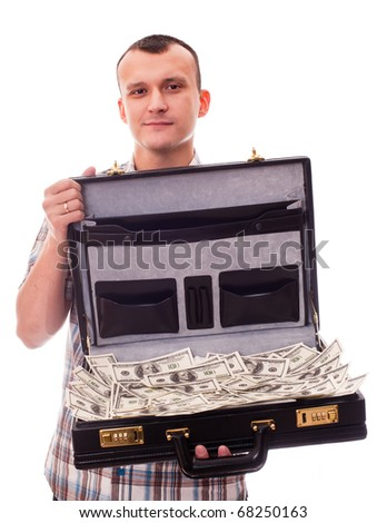 young man with suitcase full of money - stock photo