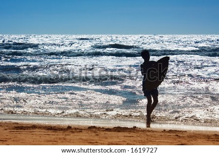 young man with surfboard - stock photo