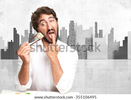 young man with sushi vomit concept - stock photo