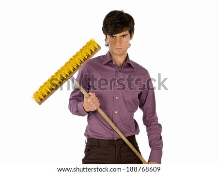 Young man with swiping brush. - stock photo