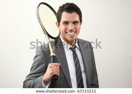 young man with tennis racket - stock photo