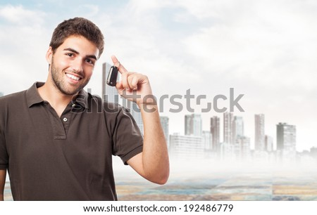 young man with the keys of his new car - stock photo