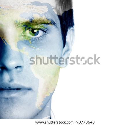 Young man with the world painted on the face - stock photo