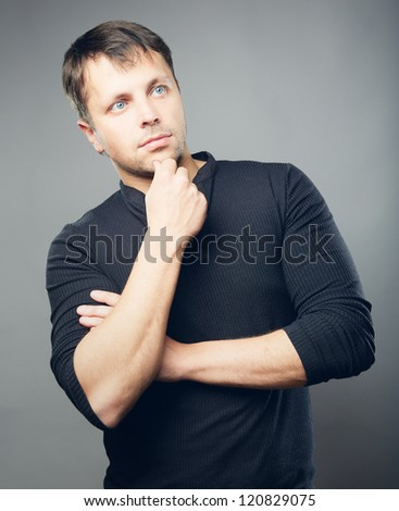 Young man with thoughtful expression - stock photo