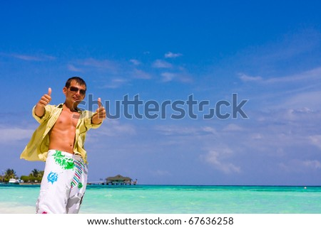 Young man with thumb up - stock photo