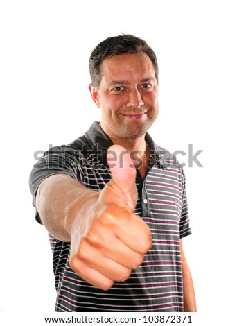 Young man with thumb up to give his approval - stock photo