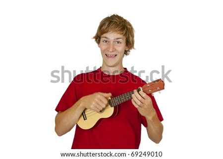 Young man with ukulele isolated on white background - stock photo