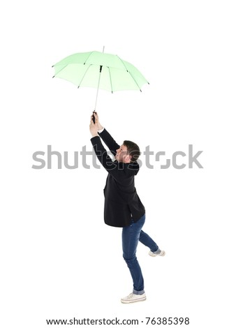 Young man with umbrella isolated on white background - stock photo