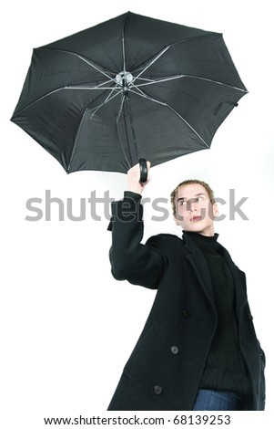 young man with umbrella over white - stock photo
