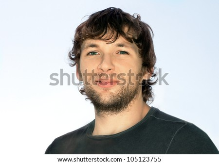Young Man with ?urly Hair and Beard Face attractive - stock photo