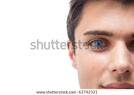 Young man with vivid blue eye macro isolated on white - stock photo