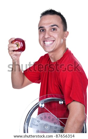 young man with weigh and red apple - stock photo