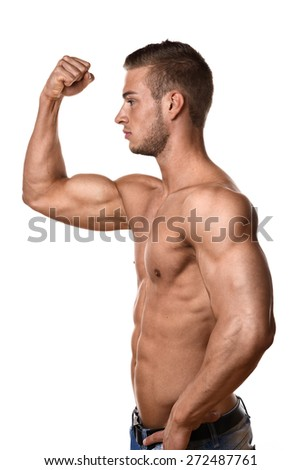 Young man with well trained body, abs and pecs and wearing a denim trousers - stock photo
