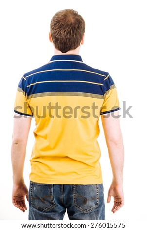 Young man with yellow polo shirt on a white background. - stock photo