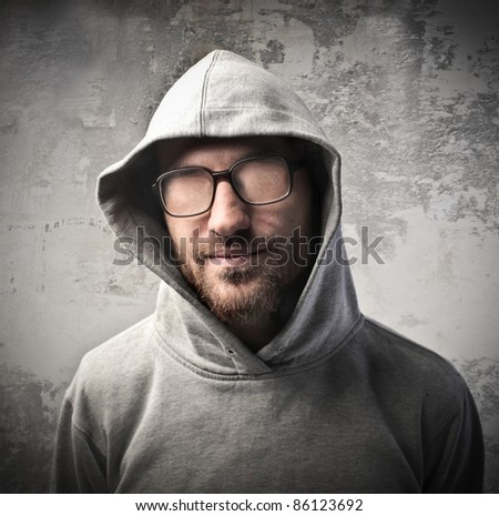 Young man without eyes behind his eyeglasses - stock photo