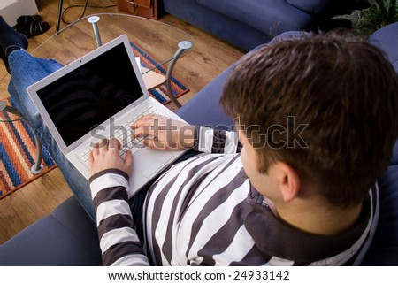Young man work with computer at home