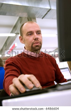 Young man working at the computer in the office
