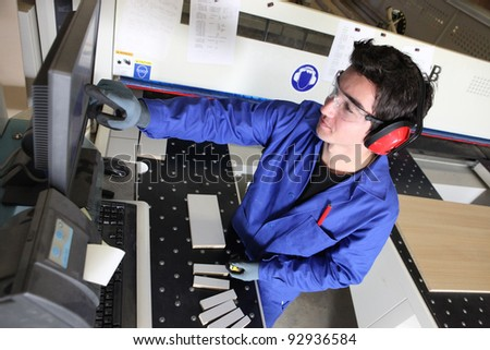 Young man working in a warehouse - stock photo