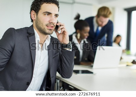 Young man working in the office - stock photo