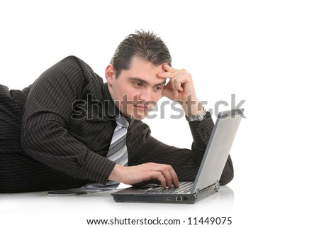 Young man working on a laptop computer - stock photo