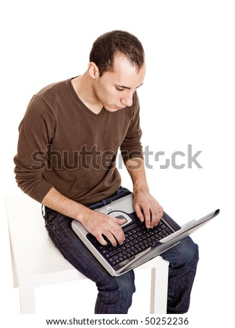 Young man working on a laptop, isolated on white