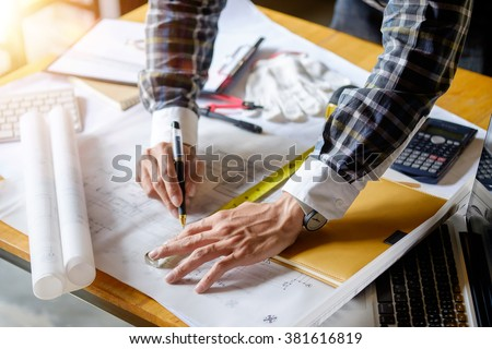 Young man working on his plane project at site construction work. - stock photo