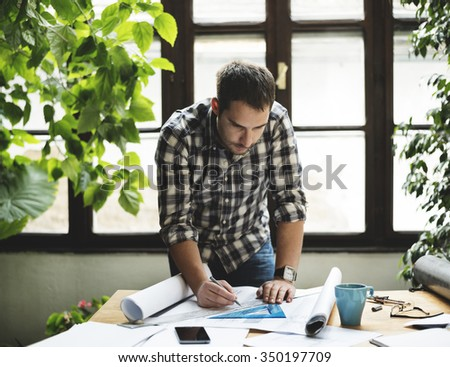 Young man working on his project. - stock photo