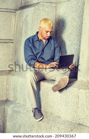 young man working outside wearing blue stock photo