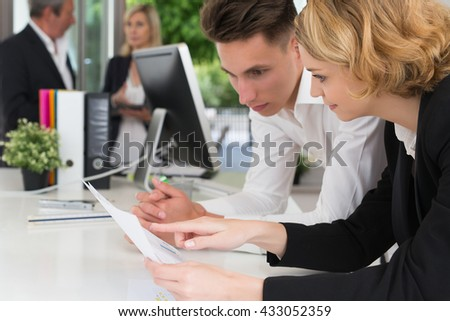 young man working with his manager