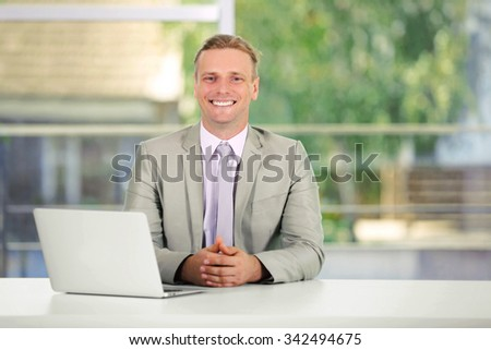 Young man working with laptop in the office - stock photo