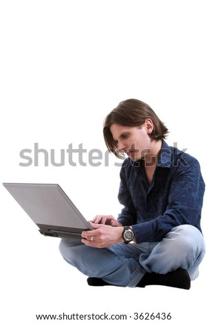 Young man works with a laptop. The studio shooting, isolated on a white background