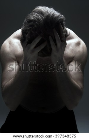 Young Man Worries and Upset - stock photo