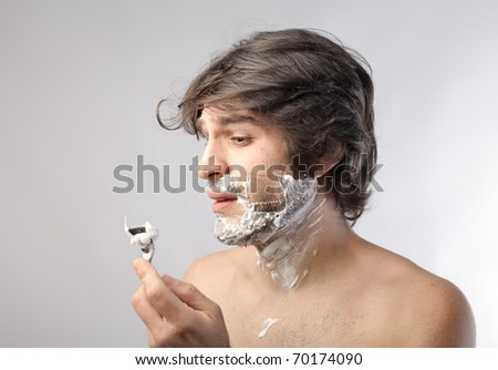 Young man wounded while shaving - stock photo