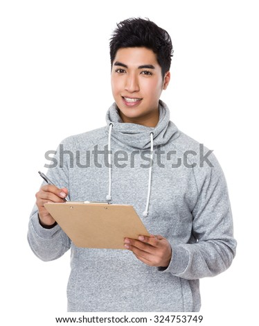 Young man write on clipboard - stock photo
