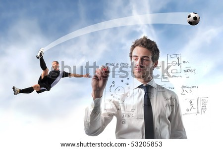 Young man writing a soccer strategy with young football player on the background - stock photo