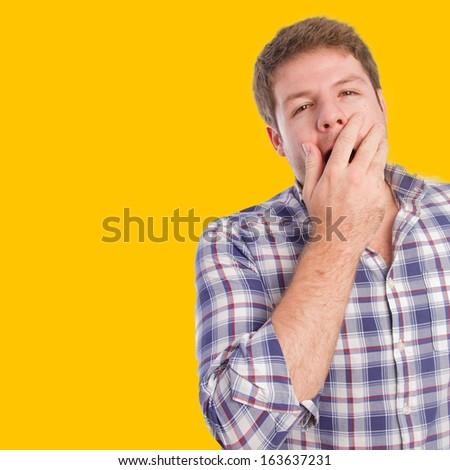 young man yawning - stock photo