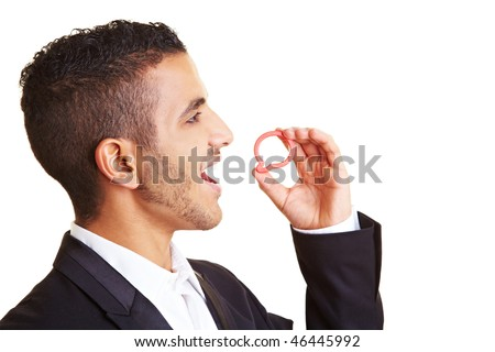 Young manager holding speech bubble in front of his mouth - stock photo