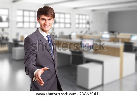 young manager in an office environment ready to shake hands - stock photo