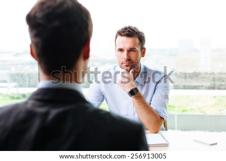 Young manager interviewing a potential worker - stock photo