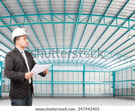 young manager man working in side of empty  warehouse use for industry background and multipurpose - stock photo