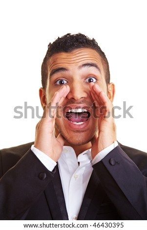 Young manager screaming with hands on his mouth - stock photo
