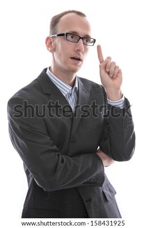 Young manager wearing suit has an idea , finger up , isolated on white background