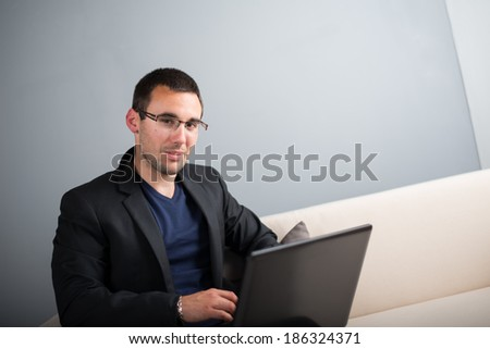 young manager working on his laptop computer