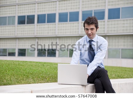 young manager working wireless outdoor - stock photo