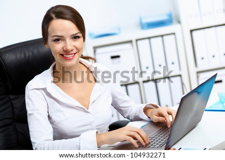 Young manager working with notebook in the office - stock photo