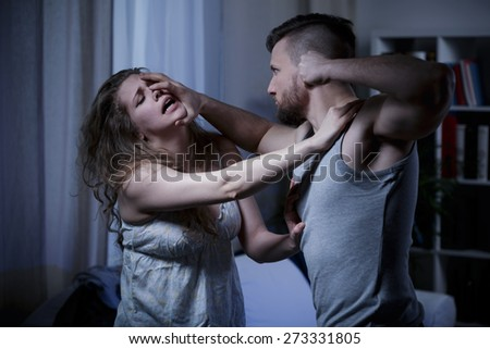 Young marriage terrible fighting with fists - stock photo