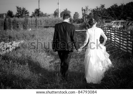 Young married couple walking on a countryside trail - stock photo