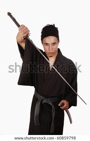 Young martial artist practising Iaido with a sword and with typical japanese kimono. - stock photo
