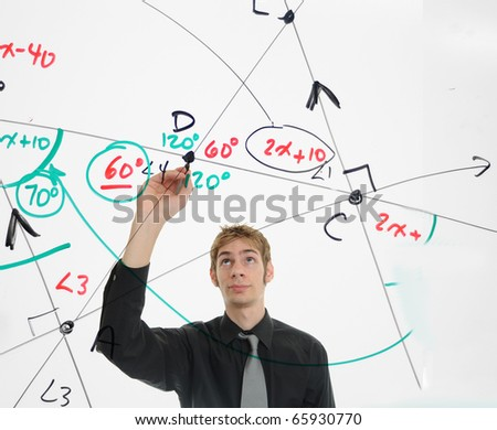 Young mathematician figures out a math problem on the whiteboard using geometry and algebra.