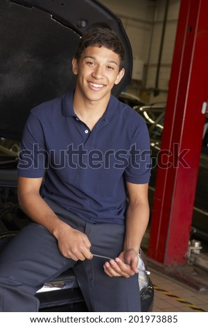 Young mechanic at work - stock photo